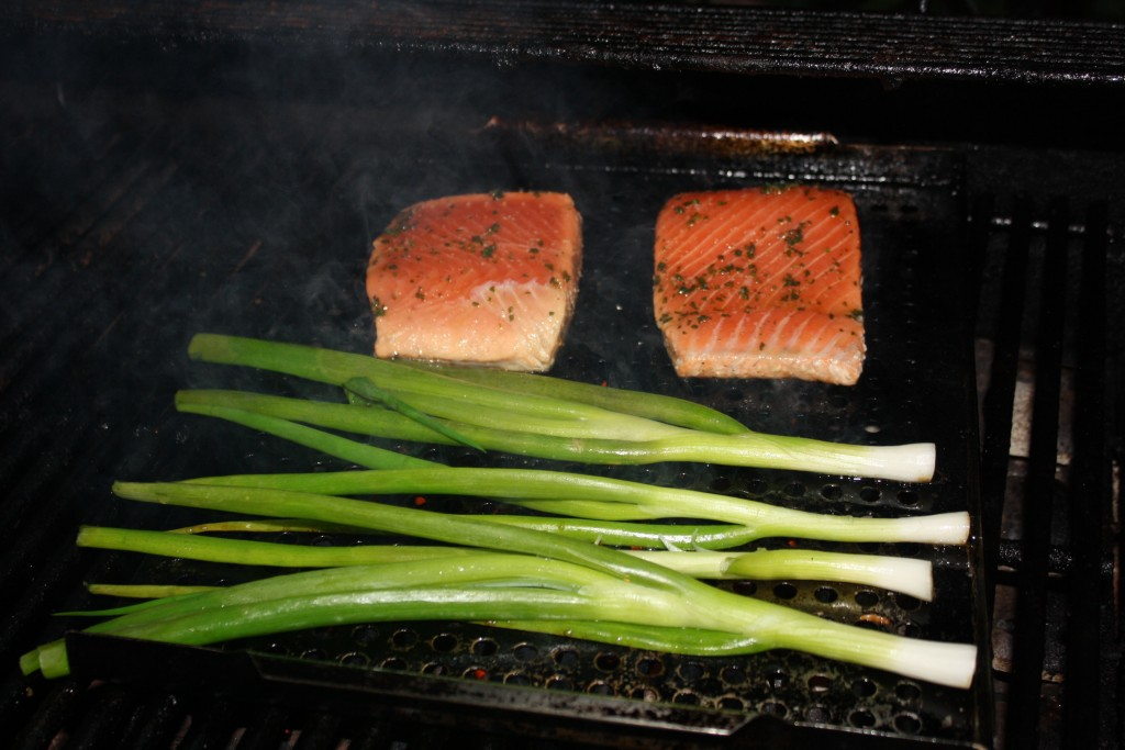 Salmon with green onion on the grill