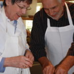 Gary and Kay preparing preserved lemons for Chicken 150x150 Secrets of the CIA:  Team Cooking by AIWF Members from Across the Country