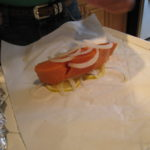 Salmon with onion and lemon slices 150x150 The Paper Boy Delivers:  Parchment Paper Wrapped Salmon