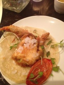 Soft Shell Crab Tacos with lightly roasted tomato petal and lime mayo.